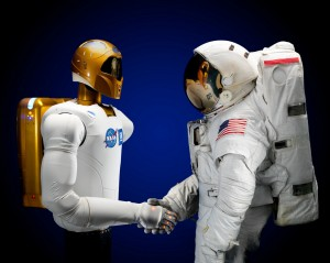Robonaut shakes hands with an astronaut